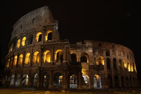 nighttime: The Colosseum in Rome, Italy.  Built completed in 80 AD.  It was built by the Emperors Vespasian and Titus. Stock Photo
