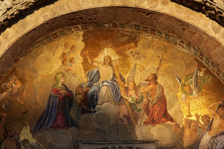 The gorgeous mosaic featuring Jesus and the cross, above the entrance to St. Mark's basilica. Editorial