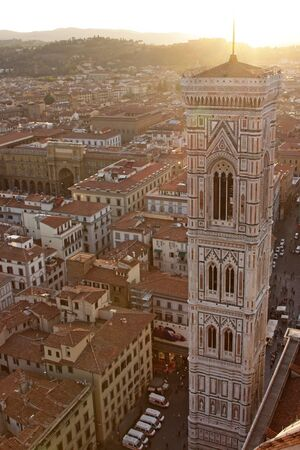 Giotto's Bell Tower shot from the top of Duomo at dusk.  The tower is located in Florence, Tuscany, in Italy.