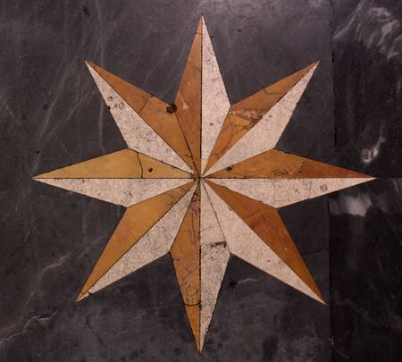 A star pattern on a marble floor.