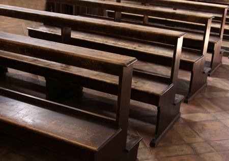 pews: Worn Church pews in a basilica in Italy.