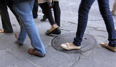 foot steps: The feet of people on the move outdoors. Editorial