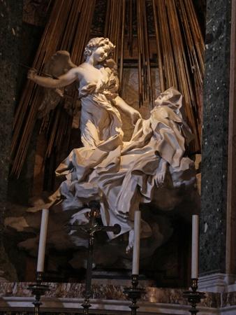 ecstasy: The Ecstasy of Saint Teresa, located in  Santa Maria della Vittoria, Rome, Italy.  The sculpture was by Giovanni Lorenzo Bernini.  Stock Photo