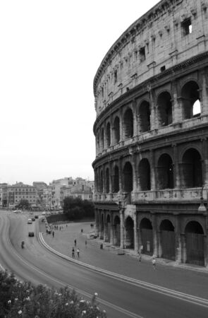 The Colosseum in Rome, Italy.  Built completed in 80 AD.  It was built by the Emperors Vespasian and Titus.  photo
