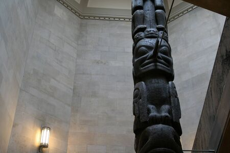 the totem pole: A totem pole that sits in the stairwell of the ROM. (Royal Ontario Museum) The ROM is located in Toronto, Ontario, Canada.