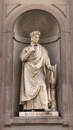 dante alighieri: A statue of Dante Alighieri sitting outside of the Uffizi, in Florence, Italy.  Dante was a  poet, writer and moral philospher.