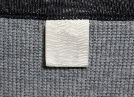 A grey shirt and a white label.