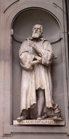 A statue Galileo Galilei sitting outside of the Uffizi, in Florence, Italy.  Galileo is a famous astronomer. Stok Fotoğraf