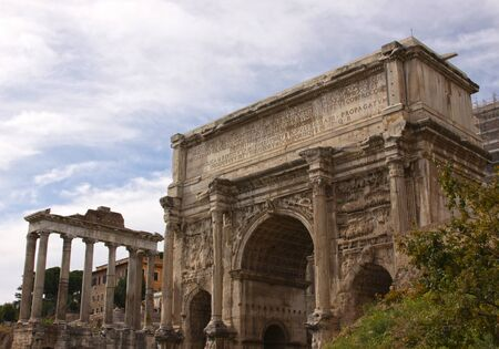 The Arch of Septimius Severus with the Temple of Saturn, in the background in the Roman Forum in Rome, Italy.