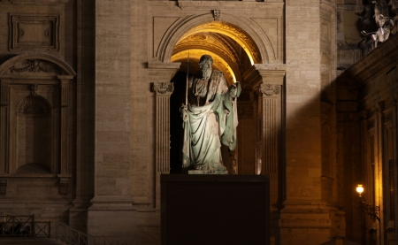 A statue of St. Paul outside St. Peters Basilica, Vatican City, Rome.  Shot at night.  photo
