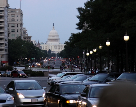 The traffic in Washington DC, with the Capitol building in the background.