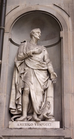 cartographer: A statue Amerigo Vespucci sitting outside of the Uffizi, in Florence, Italy.  Amerigo Vespucci was an explorernavigator whose name derived the name for North and South America. Editorial