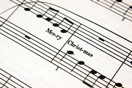carols: Merry Christmas text on a sheet of music.