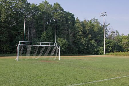 A view of the goal on a vacant soccer pitch. photo