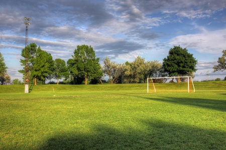 goalline: An empty soccer goal with trees in the background. (HDR photo)