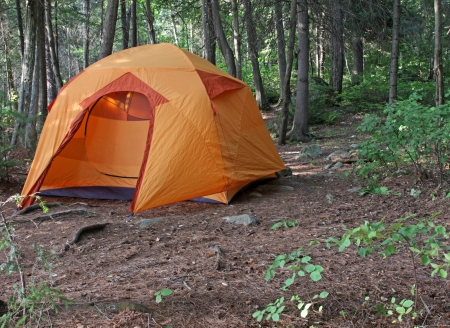 contryside: An orange tent sitting in Algonquin Provincial Park in Ontario, Canada.
