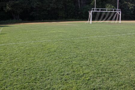 goalline: A view of the goal on a vacant soccer pitch  Stock Photo