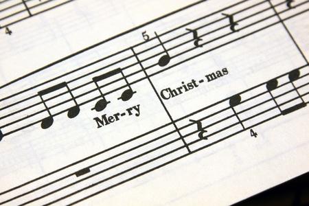 letras musicales: Feliz Navidad texto en una hoja de m�sica. Foto de archivo