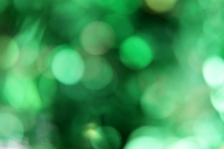 A green blurred background with dark and light patches.