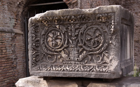 roman empire: A stone block carved with a floral decoration created by the Roman Empire.  The block is located in the Roman Forum in Rome, Italy.