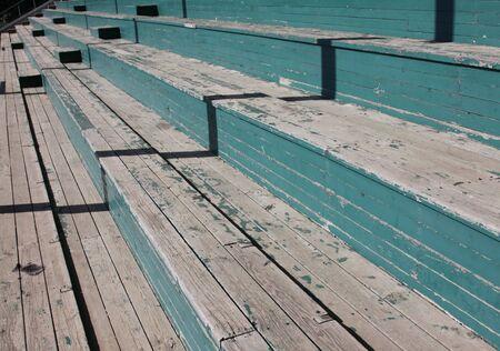 baseball field: Wooden bleachers at a baseball field.