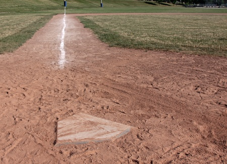 baseball diamond: A view down the left field line of a baseball field shot from home plate.