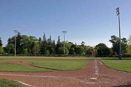 campo de beisbol: Una foto de un campo de b�isbol desocupada al atardecer.