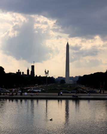 The Washington monument in the distance reflecting in a pool.