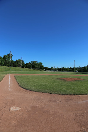 A wide-angle shot of an unoccupied baseball field.  Stock Photo
