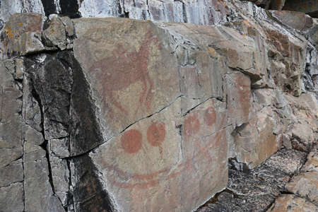 17th: The Horse Rider and Four Spheres, is a scene that is part of the Agawa Rock Pictographs.  The rock art was created by the Ojibway people in the 17th or 18th centuries.  The site is found in Lake Superior Provincial Park, in Ontario, Canada.