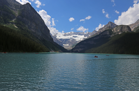 banff national park: Canoers on beautiful Lake Louise, located in Banff National Park, Alberta, Canada.