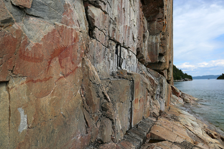 17th: The Mishibizhiw or Great Lynx, along with canoes and serpents, are part of the Agawa Rock Pictographs.  The rock art was created by the Ojibway people in the 17th or 18th centuries.  The site is found in Lake Superior Provincial Park, in Ontario, Canada.