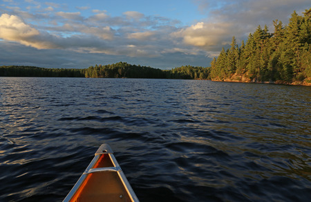 canoe paddle: The view from a canoe, gliding on a lake in Algonquin Provincial Park, in Ontario, Canada. Stock Photo
