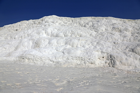A limestone wall at Pamukkale, which means cotton castle in Turkish.  It is natural site in southwest Turkey.