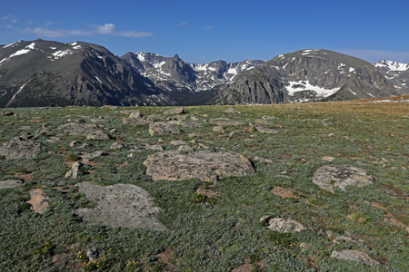 The tundra just off of the Trail Ridge Road in Rocky Mountain National Park, Colorado.  The mountain peaks in the background from left to right are, Stones Peak, Sprague Mountain, Hayden Spire, Terra Thomah Mountain and Mount Ida.