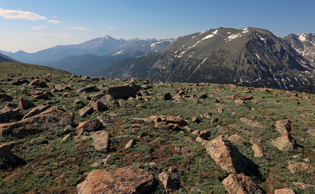 The tundra just off of the Trail Ridge Road in Rocky Mountain National Park, Colorado.  The mountain peaks in the background features Stones Peak prominently on the right. Stock Photo - 119302053
