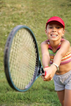 beautiful preteen girl: Smiling preteen girl playing tennis Stock Photo