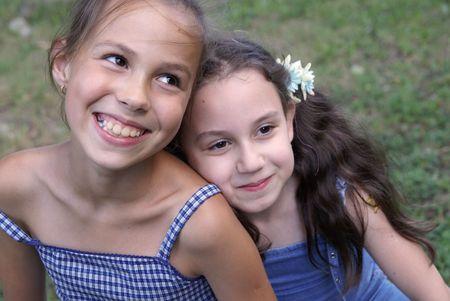 preteens girl: Two preteen girls enjoying summer outdoors Stock Photo
