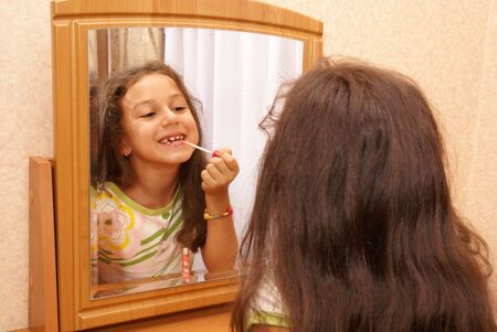 Preteen girl getting ready for party                    photo