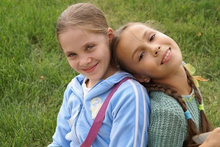 Two preteen girls having fun outdoors