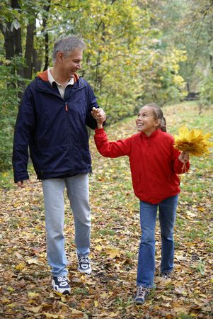 Cheerful father and daughter walking in autumn park Фото со стока - 3710760