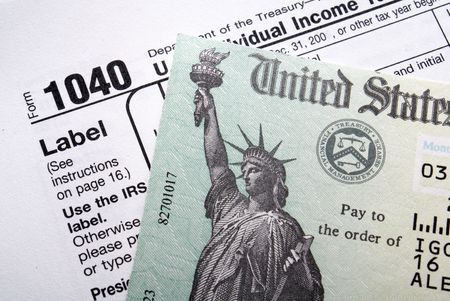 tax law: Tax return check on 1040 form background