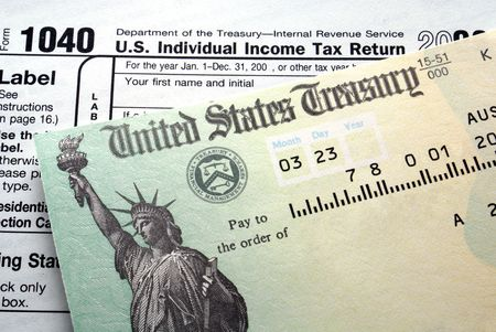 tax return: Tax return check on 1040 form background                                         Stock Photo