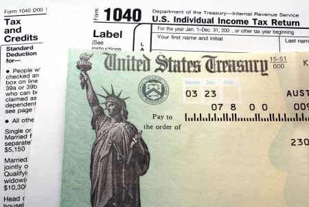Tax return check on 1040 form background                                         Stock Photo