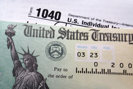 Tax return check on 1040 form background                                         photo