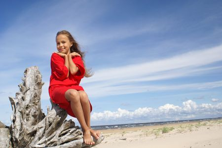 Smiling preteen girl on a beach