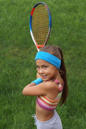 preteens girl: Smiling preteen girl playing tennis Stock Photo