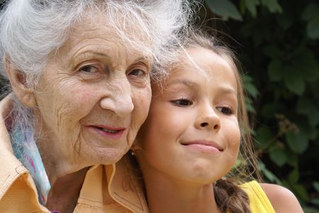 beautiful preteen girl: Granddaughter and her grandmother talking                     Stock Photo