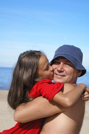 preteens beach: Cheerful father and daughter on a beach Stock Photo