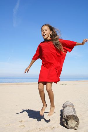 petite: Cheerful preteen girl on a beach